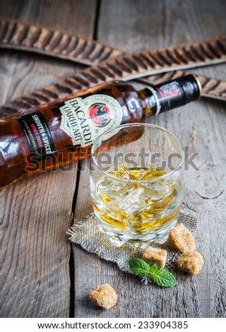 SUMY, UKRAINE - NOV 23, 2014: Bacardi Oakheart rum bottle and glass. Bacardi Oakheart spiced rum is crafted  from heavily charred oak barrels to give it a unique, smoky flavor. - stock photo