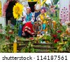 SUMY, UKRAINE - SEPTEMBER 22: Women wearing historical costume posing in traditional village background on annual agro exhibition SUMY-2012 on September 22, 2012 in Sumy, Ukraine - stock photo