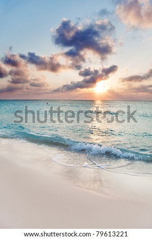 Sun about to set over Seven Mile Beach, Grand Cayman - stock photo