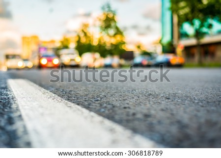 Sun after the rain in the city, view of the approaching cars with the level dividing line - stock photo