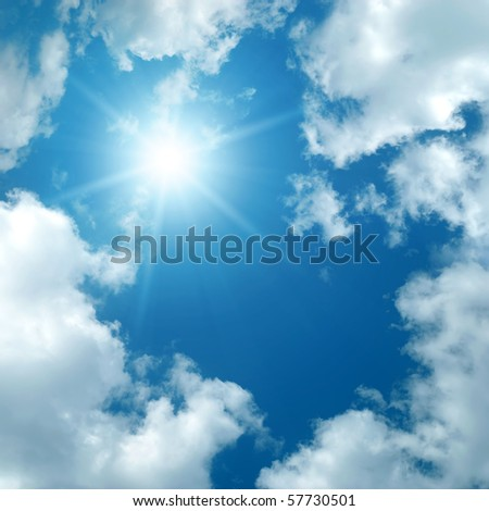 sun among the clouds on blue sky - stock photo