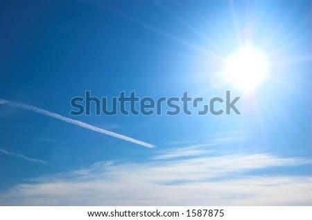 Sun and blue sky - stock photo