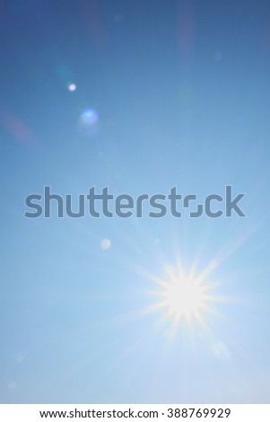 sun and blue sky, long rays and glare - stock photo