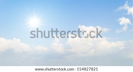 sun and blue sky with clouds - stock photo
