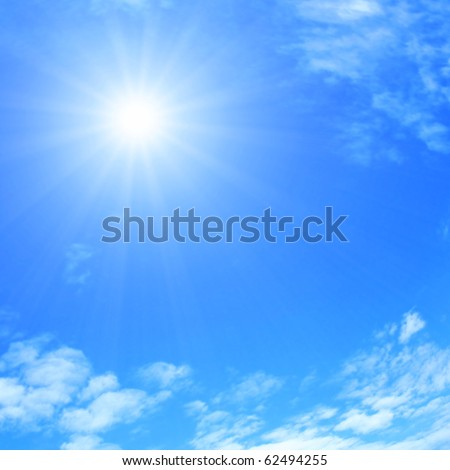 Sun and blue sky with clouds. - stock photo