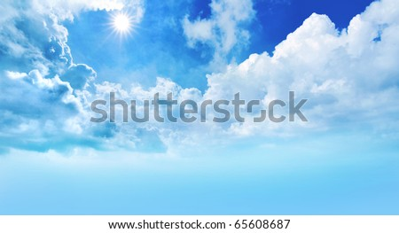sun and bright blue sky with white clouds - stock photo
