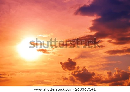 Sun and clouds background - stock photo