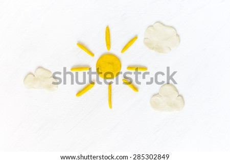 Sun and clouds on sky made from plasticine - stock photo