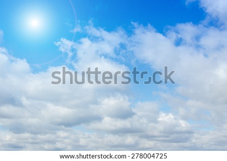 Sun and clouds on the summer sky - stock photo