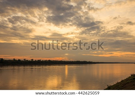 Sun and clouds over river