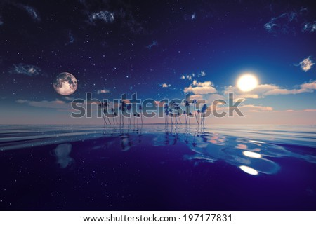 sun and moon behind island with coconut palms - stock photo