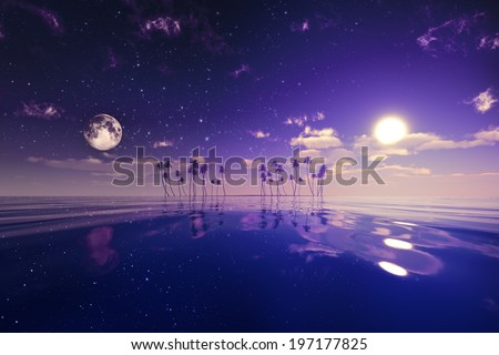 sun and moon behind island with coconut palms purple toned image - stock photo