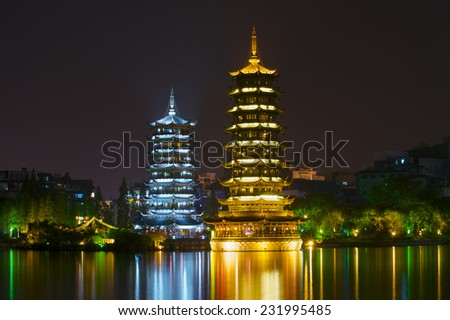 Sun and Moon pagodas at Banyan Lake, Guilin, Guangxi, China  - stock photo