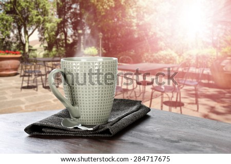 sun and mug of coffee  - stock photo