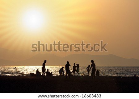 Sun and silhouettes on the beach