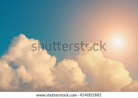 Sun and sky with clouds at sunrise or sunset - stock photo