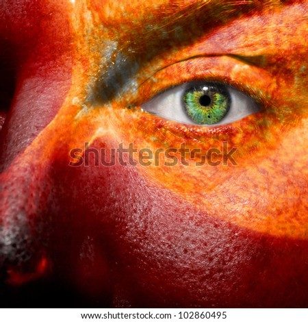Sun and sun flare painted on a face to show medical conditions concept such as sensitive skin or inflammation. Can als be used to portray a hothead or angry person. - stock photo