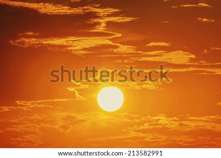 Sun at sunrise / sunset with clouds - stock photo