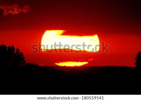 Sun at sunset  - stock photo