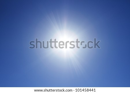 Sun at the clear blue sky - stock photo