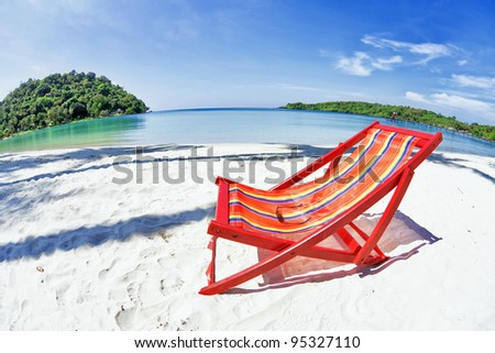 sun beach chair on shore near sea. Thailand - stock photo