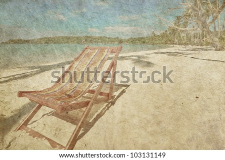 sun beach chairs on shore near sea in grunge and retro style - stock photo