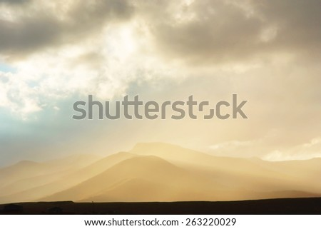 Sun beams in mountains. Shot near Katse Dam, Lesotho. - stock photo