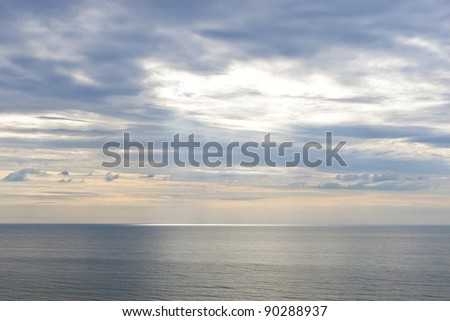 Sun beams on ocean at early morning