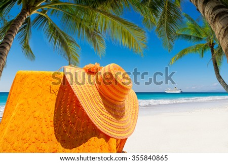 Sun bed lounger at the tropical beach - stock photo