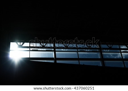 sun behind window