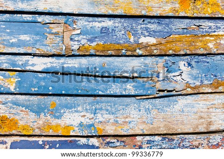 Sun-Bleached Peeling Paint on an Old Wooden Boat - stock photo