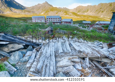 Sun-bleached wooden planks all that remain of a log cabin in a gold mine in the Alaska wilderness. - stock photo