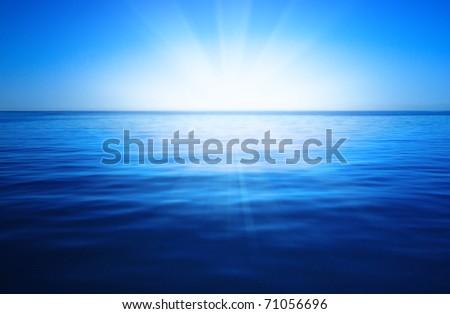 Sun, blue sky and ocean - stock photo