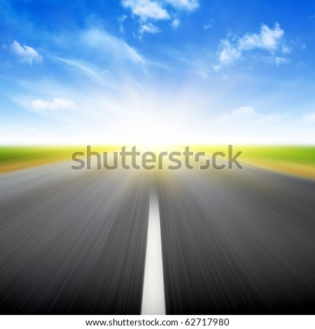 Sun,blue sky and road with motion blur. - stock photo