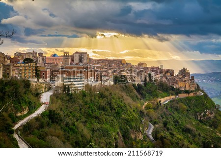 sun breaking through the clouds above the highest city in Sicily - Enna - stock photo
