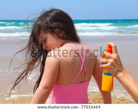 Sun care on the beach - stock photo
