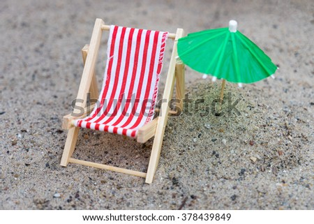 Sun chair and umbrella stand in the sand / Sun Chair - stock photo