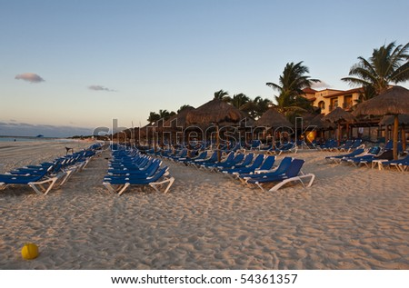 Sun-chairs and umbrellas on Caribbean Beach