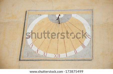 Sun clock on a wall of the City hall in the medieval town Entrevaux (Alpes de Haute Provence, France) - stock photo