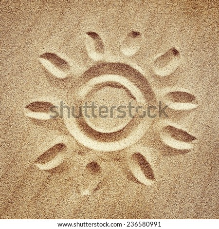 Sun drawn in the sand - stock photo