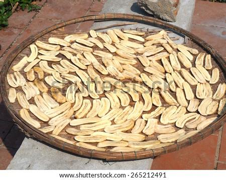 Sun-dried Banana on a rice-winnowing basket Thai style.         - stock photo