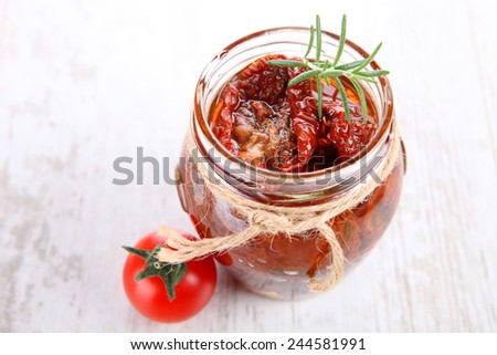 Sun dried tomatoes with olive oil in a jar  - stock photo