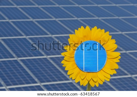 sun flower and solar panel as symbol for solar energy - stock photo