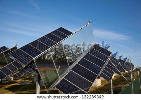 Sun following solar cells farm - stock photo