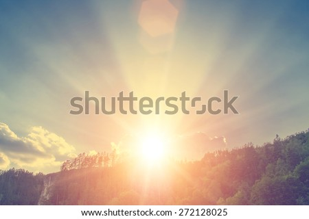 Sun from green mountains - stock photo