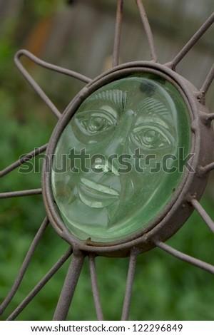 Sun Garden Decor, Smiling Face - stock photo