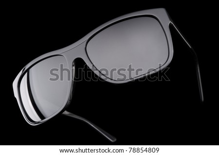 sun glasses on dark background - stock photo