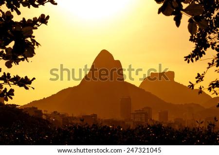 Sun Goes Down Behind the Mountains of Rio de Janeiro, Brazil - stock photo