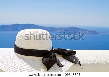 Sun hat on a ledge with ocean background - stock photo