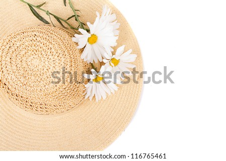 Sun hat with white daisies on white background - stock photo